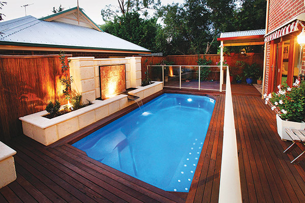 """""""Aqua Gym"""" Fibreglass Swimming Pool Design, surrounded by decking and with a water feature"""