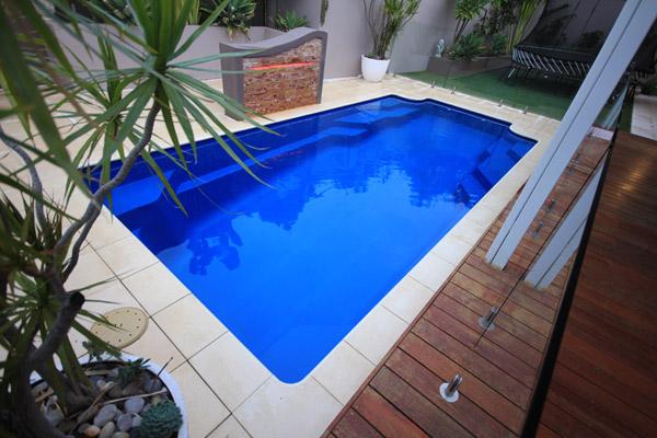 """Riviera"" Fibreglass Swimming Pool Design, pictured in decked backyard"